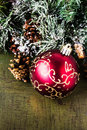 Christmas composition with decorations on dark wooden backgro big red ball and background merry and happy new year card Stock Photography