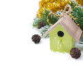Christmas composition with fir branches pine cones decorations and birdhouse isolated on white Royalty Free Stock Image