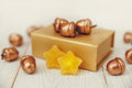 Christmas composition.Golden present box and golden acorns.White wooden table,jujube stars Royalty Free Stock Photo
