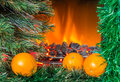 Christmas composition with oranges new year near the fireplace Royalty Free Stock Photos