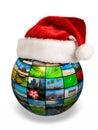 Christmas concept - photo globe in Santa hat Royalty Free Stock Photo