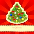 Christmas congratulations card fir with baubles and bow on red background Royalty Free Stock Photography