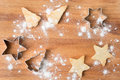 Christmas cookies and baking dish on a wooden board with space for text top view Royalty Free Stock Images