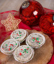 Christmas cookies and cream cheesecakes in muffin forms Stock Photography