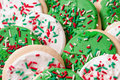 Christmas cookies decorated with red white and green sprinkles shallow definition of field with selective focus Royalty Free Stock Images