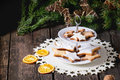 Christmas cookies with festive decor glazed star shapes on ceramic cake plates tree and dry sliced orange over old wooden table Stock Image