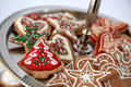 Christmas cookies gingerbread decorated with icing and sprinkles for Stock Photo