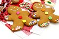 Christmas cookies gingerbread men and candy canes on checked cloth Stock Photos