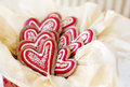 Christmas cookies heart shaped gingerbread decorated in red and gold for Royalty Free Stock Photo
