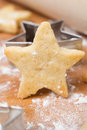 Christmas cookies in the shape of stars on a wooden board close up Royalty Free Stock Images
