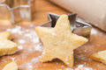 Christmas cookies in the shape of stars on wooden board closeup a close up horizontal Royalty Free Stock Images