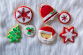 Christmas cookies xmas tree santa snowflake on white fur background Royalty Free Stock Image