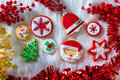 Christmas cookies xmas tree santa snowflake on white fur background Royalty Free Stock Photography