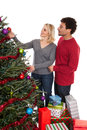 Christmas couple decorating tree diverse middle aged a isolated on white background Stock Photos