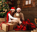 Christmas couple in rural wooden house played a plush toy Royalty Free Stock Photo