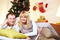Christmas cuddlers portrait of a married couple cuddling on a eve Royalty Free Stock Image