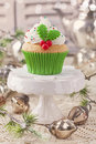 Christmas cup cake with holly berry Royalty Free Stock Photography