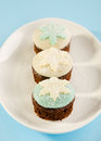 Christmas cupcake with white and blue snow flake decoration on Stock Photos