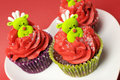 Christmas cupcakes with fun and quirky reindeer faces angle face toppings in modern festive red lime green colors for or Stock Images