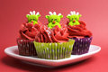 Christmas cupcakes with fun and quirky reindeer faces face toppings in modern festive red lime green colors for or Royalty Free Stock Images