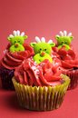 Christmas cupcakes with fun and quirky reindeer faces vertical face toppings in modern festive red lime green colors for or Royalty Free Stock Photography