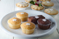 Christmas cupcakes and mince pies a selection of individual plated cakes in foil dishes on an old farmhouse kitchen table Stock Photography
