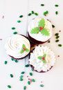 Christmas cupcakes on a wooden table Royalty Free Stock Photos