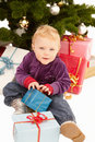 Christmas - Cute child opening gifts Royalty Free Stock Images