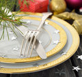 Christmas cutlery on a gray table Stock Photo