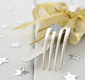 Christmas cutlery on a white table Royalty Free Stock Photography