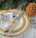 Christmas cutlery on a white table Stock Photos