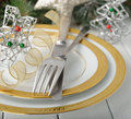 Christmas cutlery on a white table Royalty Free Stock Photo