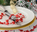 Christmas cutlery on a white table Royalty Free Stock Photos
