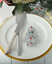 Christmas cutlery on a white table Royalty Free Stock Images