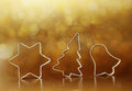 Christmas cutters on the golden background Royalty Free Stock Photography