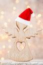 Christmas decor with angel santa hat. Vintages background.