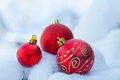 Christmas decor ball on snow balls Royalty Free Stock Photos