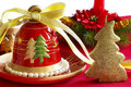 Christmas decor with bell and candel Stock Photos