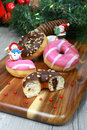 Christmas decor donuts sweet doughnut colored glazed bun on a wooden cutting board in decoration Stock Photography