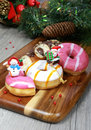 Christmas decor donuts sweet doughnut colored glazed bun on a wooden cutting board in decoration Royalty Free Stock Photo
