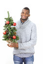 Christmas decorating happy man holding tree with decorations and ornaments Royalty Free Stock Images
