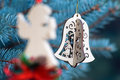 Christmas decoration of angel and handmade bell Stock Images