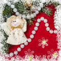 Christmas decoration and angel toy on red textile Royalty Free Stock Photos