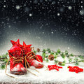 Christmas decoration with antique baby shoes. Falling snow Royalty Free Stock Photo