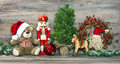 Christmas decoration. Antique toys Teddy Bear and Nutcracker Royalty Free Stock Photo
