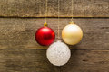 Christmas decoration balls hanging on a wooden wall Stock Photo