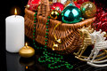 Christmas Decoration in basket and burning candles Stock Image