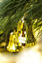 Christmas decoration bell close up on pine Royalty Free Stock Photography
