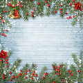 Christmas decoration with bell and holly on a wooden background Royalty Free Stock Photo