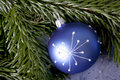 Christmas decoration blue ball with pattern and pine branch Royalty Free Stock Photo